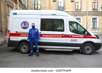 St. Petersburg, Russia - July 18, 2020: A doctor in a protective suit with a steamer next to an ambulance during the Covid-19 epidemic