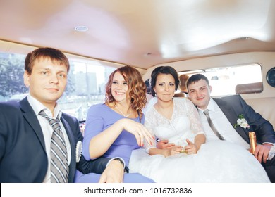ST PETERSBURG, RUSSIA - JULY 22, 2017: Wedding Event. Newlyweds Wedding Couple Bride and Groom with Friends in the Wedding Car