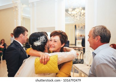 ST PETERSBURG, RUSSIA - JULY 22, 2017: Wedding Event. Wedding Couple Bride and Groom Accept Congratulations in the Wedding Palace during the Wedding Ceremony
