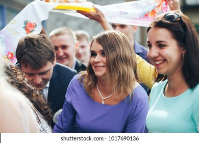 ST PETERSBURG, RUSSIA - JULY 22, 2017: Wedding Event. Bride and Groom go to Restaurant. Friends and Relatives of the Newlyweds is Meet them and Congratulate them