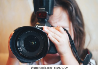 ST PETERSBURG, RUSSIA - JULY 22, 2017: Pretty Child Girl with Photo Camera at Home