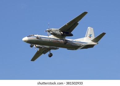 "ST. PETERSBURG, RUSSIA - JULY 24, 2015: The plane AN-26-100 ""Marshal Novikov"" (RA-27210) landing in Pulkovo airport"