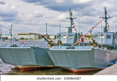 """ST. PETERSBURG, RUSSIA - JULY 25, 2019: Photo of Project 11770 landing craft. D-1441 """"Alexey Barinov"""" landing craft with an armored personnel carrier BTR-82A on Sverdlovskaya embankment."""
