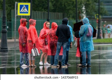 St. Petersburg, Russia - July 26, 2017: A group of people in raincoats. Rainy day.