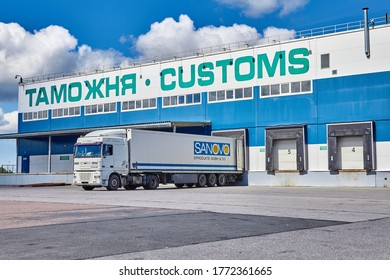 St. Petersburg, Russia - July 27, 2017: Customs house is a government office where duties are paid  on foreign shipments. A truck is standing at the unloading dock of a bonded warehouse.