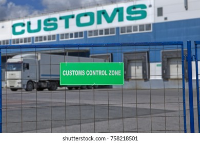 St. Petersburg, Russia - July 27, 2017: The truck is unloaded at a customs warehouse, behind a fence with a green sign, a customs control zone.