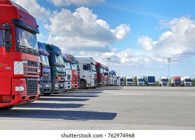 St. Petersburg, Russia - July 27, 2017: A fleet of trucks with a trailer, parking in the territory of a logistics terminal.