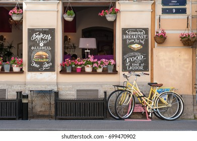 ST PETERSBURG, RUSSIA - July 28, 2016: Bicycles for rent near cafe on a city street.