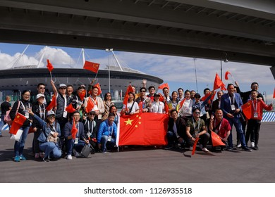 ST. PETERSBURG, RUSSIA - JULY 3, 2018: Chinese football fans at Saint Petersburg stadium during FIFA World Cup Russia 2018. The city host 7 matches of FIFA World Cup