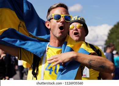 ST. PETERSBURG, RUSSIA - JULY 3, 2018: Swedish football fans singing at Saint Petersburg stadium before the match of FIFA World Cup 2018 Sweden vs Switzerland. Sweden won 1-0