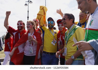 ST. PETERSBURG, RUSSIA - JULY 3, 2018: Swedish and Swiss football fans at Saint Petersburg stadium before the match of FIFA World Cup 2018 Sweden vs Switzerland. Sweden won 1-0