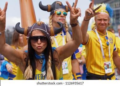ST. PETERSBURG, RUSSIA - JULY 3, 2018: Swedish football fans at Saint Petersburg stadium before the match of FIFA World Cup 2018 Sweden vs Switzerland. Sweden won 1-0