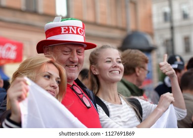ST. PETERSBURG, RUSSIA - JULY 3, 2018: English football fans make photo at FIFA Fan Fest in Saint Petersburg during the FIFA World Cup 2018 match Colombia vs England. England won 4-3