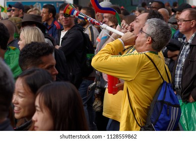 ST. PETERSBURG, RUSSIA - JULY 6, 2018: Brazilian football fans with vuvuzela at FIFA Fan Fest in Saint Petersburg before quarterfinal match of FIFA World Cup 2018 Brazil vs Belgium. Belgium won 2-1