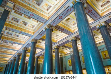 St. Petersburg, Russia - July 7, 2019: Interiors of Hermitage Museum, decoration on ceiling and marble pillars