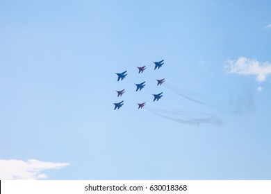 St Petersburg Russia - July 8, 2013: Naval Salon IMDS 2013 Airshow in Port Area of Saint-Petersburg with Piloting Military Jets Mig-29 and Su-34 and Training Planes