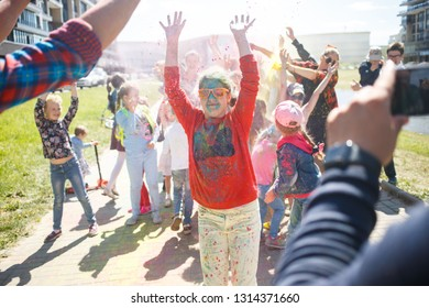 St. Petersburg, Russia, June, 01, 2018: Children's Day and the festival of colors of holi. Fun and dance with colors Holi in the summer on a city street.