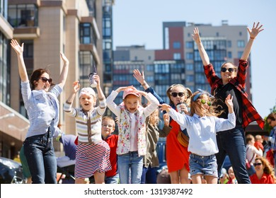 St. Petersburg, Russia, June, 01, 2018: Children's Day. Fun and dance with  in the summer on a city street. Happy kids outdoors in summer