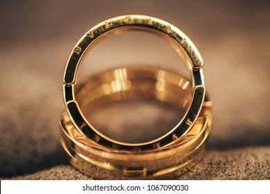 ST PETERSBURG, RUSSIA - JUNE 12, 2015: Wedding Accessories. BVLGARI Brand. Expensive Golden Wedding Rings