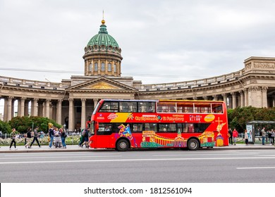 St. Petersburg, Russia, June 13, 2020. Red sightseeing bus travels along beautiful street of the city street. Kazan Cathedral a distance