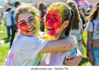 ST PETERSBURG, RUSSIA - JUNE 13, 2015: Teenagers take part in Holi festival. It is a holiday celebrated as a festival of colours.