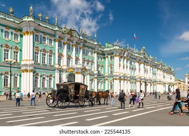 ST PETERSBURG, RUSSIA - JUNE 14, 2014: The Winter Palace on the Palace Square in summer in Saint Petersburg. It was a main palace of Russian Empire and is a tourist attraction of the Petersburg city.
