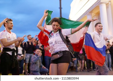 ST. PETERSBURG, RUSSIA - JUNE 15, 2018: Iranian football fans dancing on Nevsky avenue in Saint Petersburg on the day of first match of FIFA World Cup 2018 in the city. This match is Iran vs Morocco