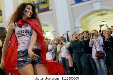 ST. PETERSBURG, RUSSIA - JUNE 15, 2018: Moroccan football fans dancing on Nevsky avenue in Saint Petersburg on the day of first match of FIFA World Cup 2018 in the city. This match is Iran vs Morocco