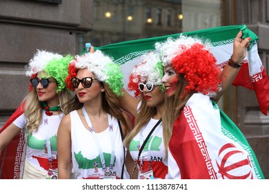 ST. PETERSBURG, RUSSIA - JUNE 15, 2018: Iranian football fans with national flag in Saint Petersburg on the day of first match of FIFA World Cup 2018 in the city. This match is Iran vs Morocco