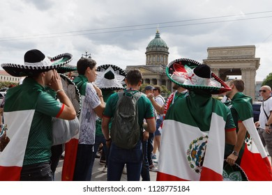 ST. PETERSBURG, RUSSIA - JUNE 15, 2018: Mexican football fans on Nevsky avenue of Saint Petersburg during FIFA World Cup Russia 2018. Saint-Petersburg hosts 7 matches of FIFA World Cup