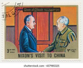 ST. PETERSBURG, RUSSIA - JUNE 15, 2016: A postmark printed in Umm-al-Qiwain, shows US President Nixon and Mao Zedong, circa 1972