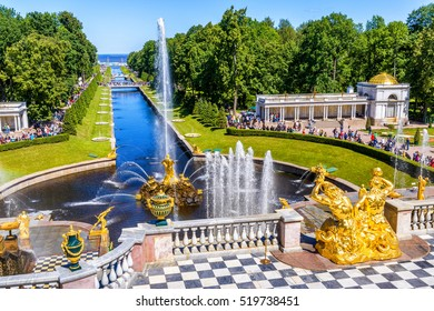 ST PETERSBURG, RUSSIA - JUNE 15, 2014: Grand Cascade and Sea Channel at Peterhof Palace. Luxurious view of Peterhof Palace in summer. Postcard of Peterhof Palace on a sunny day. UNESCO Heritage site.