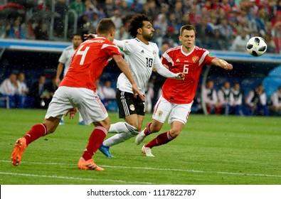 St Petersburg, Russia - June 19, 2018. Egyptian football star Mohamed Salah against Russian players Denis Cheryshev and Sergei Ignashevich during World Cup 2018 match Russia vs Egypt.