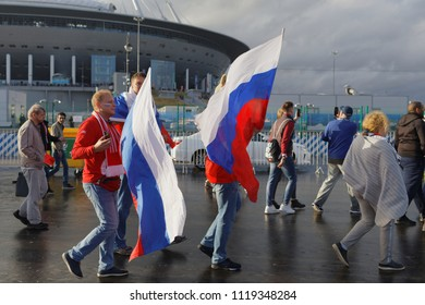 ST. PETERSBURG, RUSSIA - JUNE 19, 2018: Russian football fans with flags at Saint Petersburg Stadium before the FIFA World Cup 2018 match Russia vs Egypt. Russia won 3-1