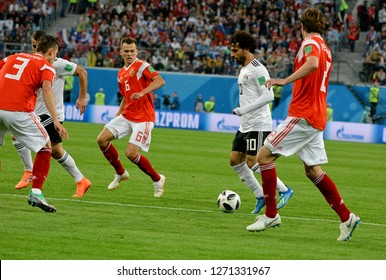 St Petersburg, Russia - June 19, 2018. Egyptian football star Mohamed Salah against Russian players Ilya Kutepov, Mario Fernandes and Denis Cheryshev during World Cup 2018 match Russia vs Egypt.