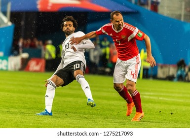 St Petersburg, Russia - June 19, 2018. Egyptian football star Mohamed Salah against Russian defender Sergei Ignashevich during World Cup 2018 match Russia vs Egypt.