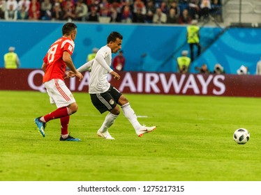 St Petersburg, Russia - June 19, 2018. Egypt national team midfielder Mohamed Abdel-Shafy against Russia national team midfielder Alexander Samedov during World Cup 2018 match Russia vs Egypt.