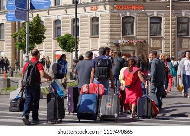 ST. PETERSBURG, RUSSIA - JUNE 20, 2018: Group of Indian football fans at Moskovsky train station of Saint Petersburg during FIFA World Cup Russia 2018. The city hosts 7 matches of FIFA World Cup