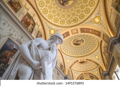 ST. PETERSBURG/ RUSSIA - June 20, 2019 : Interior of  the Hermitage Museum with marble sculpture and beautiful fresco ceiling
