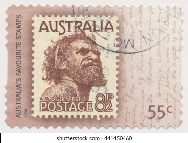 ST. PETERSBURG, RUSSIA - JUNE 22, 2016: A postmark printed in Australia, shows Aborigine (1950) series old postage stamp on a new, circa 2009