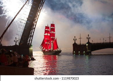 "ST. PETERSBURG, RUSSIA - JUNE 24, 2018: The brig ""Three crowns"" (Tre Cronor) passes the drawn Trinity Bridge. The holiday ""Scarlet sails"" in St. Petersburg"