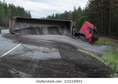 "St. Petersburg, Russia - June 25, 2018: On the international highway ""Scandinavia"" the car loaded with a sand-gravel mixture turned over, blocked traffic in two lanes and rolled into a ditch."