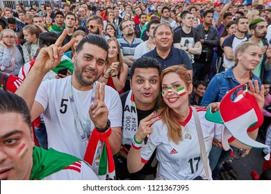 St. Petersburg, Russia - June 25, 2018: Fifa fan fest, Mundial 2018, Iranian fans of Iranian national football team cheer during  World Cup football match, between teams of Iran and Portugal.