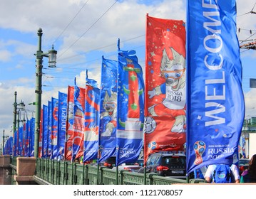 ST. PETERSBURG, RUSSIA - JUNE 25, 2018: Flags of FIFA World Cup in Russia Flattering in the Wind. Football World Cup Russia 2018 Symbols, Welcoming International Fans and Tourists to Russian Host City