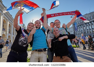 St. Petersburg, Russia - June 25, 2018: Fans of Russian national football team with national flag on Nevsky Prospekt during World Cup 2018.