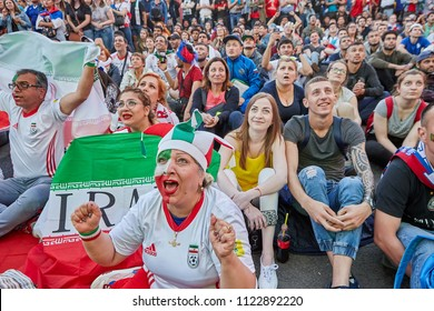 St. Petersburg, Russia - June 25, 2018:  Iranian fans watch football match on giant screen during game of  National Team of Iran in 2018 World Cup.
