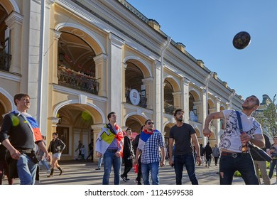 St. Petersburg, Russia - June 25, 2018:  Soccer  supporters play ball on Nevsky Prospect Saint  Petersburg during 2018 FIFA World Cup.