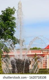 "St. Petersburg, Russia - June 25, 2019: Fountain ""Sheaf"" near Monplaisir Palace in Lower park of Peterhof in St. Petersburg, Russia"