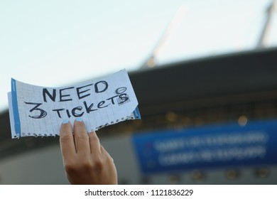 ST. PETERSBURG, RUSSIA - JUNE 26, 2018: Football fan's hand with label NEED 3 TICKETS at Saint Petersburg stadium during FIFA World Cup 2018 before the match Argentina - Nigeria. Argentina won 2-1