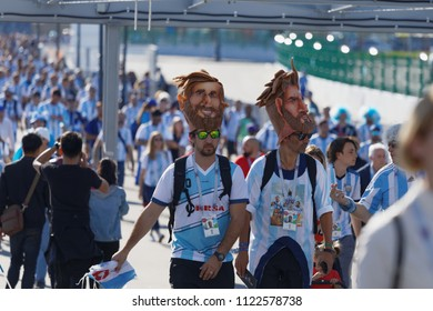 ST. PETERSBURG, RUSSIA - JUNE 26, 2018: Argentinian football fans in masks of Lionel Messi at Saint Petersburg stadium during FIFA World Cup 2018 before the match Argentina-Nigeria. Argentina won 2-1